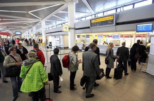 Get to the back of the line? Stand behind the 'yellow' line? Overheard at the airport: