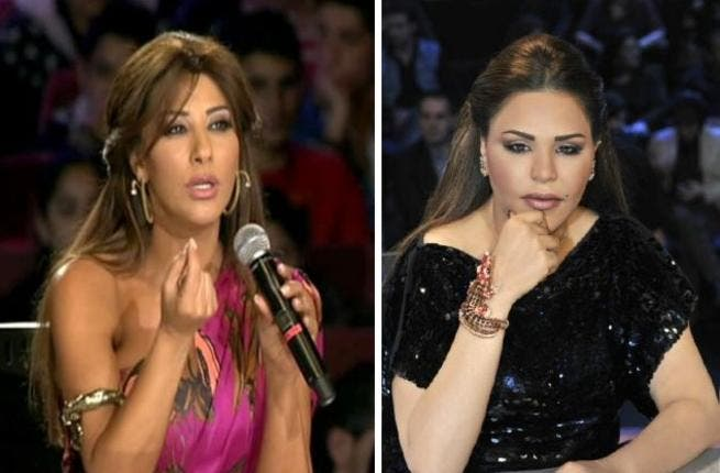 Judges Jewels have a face-off: Najwa Karam's dragon-set arm-piece jewelry takes on Ahlam's gaudy crocodile diamond encrusted bracelet that had been subject to commentary on Arab Idol.