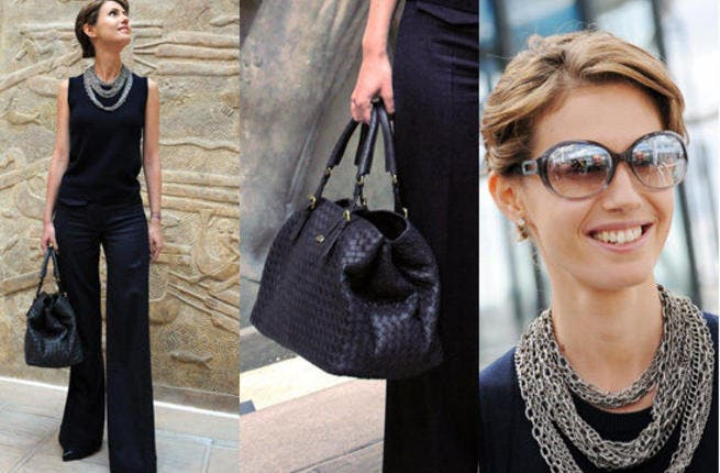 Asma Al Assad complained in a leaked email that she never had time to try on new clothes, nor more recently with the onset of pesky revolutions, the occasion for some of her more glittery numbers. But she doesn't seem to be having that problem in these photos, donning her select handbags and these thick necklaces.