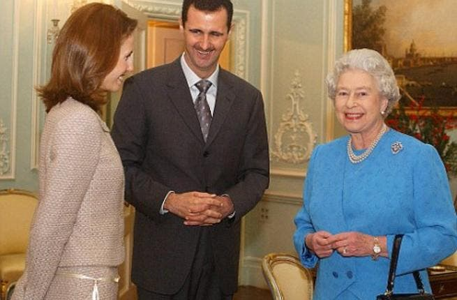 Fixed smiles all round: Asma Al Assad gets to meet the Queen of England; she may be the First Lady of Syria, but Asma can show a stiff upper lip like the British-born woman she always was. These days, the Al Assads are not likely to be courted by European leaders.