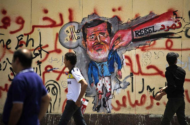 Egyptian graffiti in Cairo depicting the ousting of Morsi. (AFP/File)