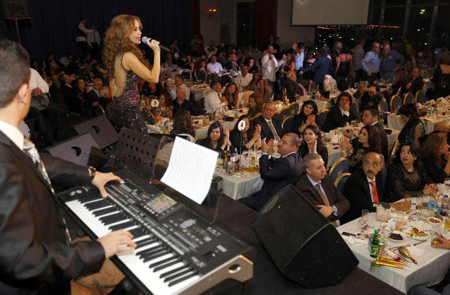 Rola Saad lent an extra touch of beauty and breeze to the Dbaya shores of Lebanon and the NY fans flocked to Le Royal hotel for some luscious entertainment, Libnani-style. Her killer black backless dress trailed the stage floor as she showed off what new song surprises she had in store for 2013.