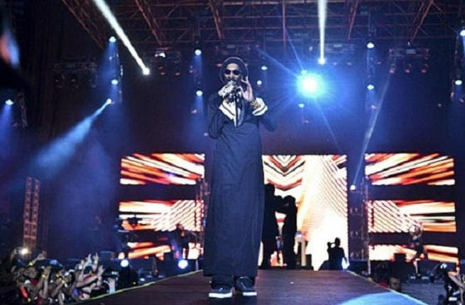 Give the dogg a microphone: Partiers welcomed in the New Year doggy-style in Dubai as Snoop treated over 15,000 fans to a headline performance at Atelier Festival, decked out in traditional Emirati dress.