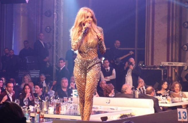 Maya Diab might have been sharing the stage with Wael Kfoury at Lebanon's Regency Palace Hotel but she made sure all eyes were on her.  Flaunting her ample assets in a figure hugging barely-there dress, her admirers were desperate to welcome 2013 with a smooch from the sexy starlet.