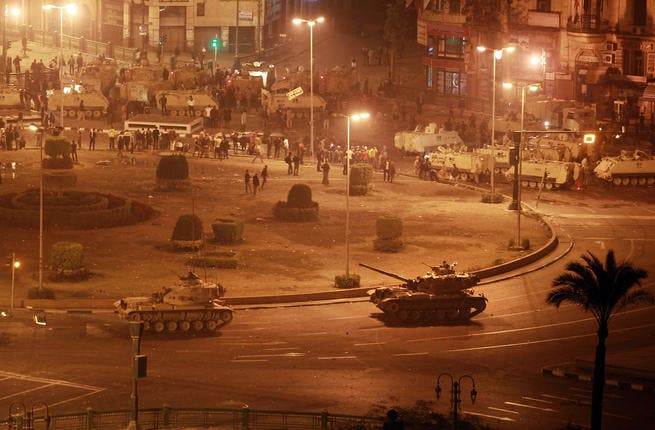 Army tanks line up in Tahrir Square.