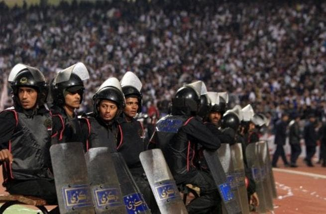 Egyptian riot police: stand guard in Cairo Stadium during the first half of a match between