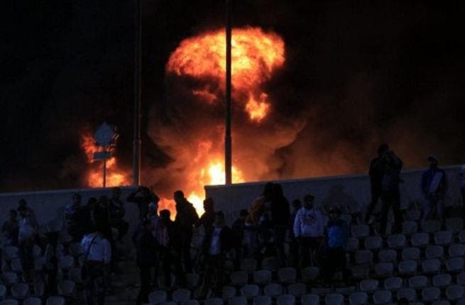 Flames rise from Cairo Stadium early in the match, Zamalek v. Ismaili clubs. Port Said has had wide repercussions just a day after, with Al Ahly Portuguese coach quitting, Port Said's governor resigning & the PM sacking officials from the EFA board. Top clubs Zamalek & Ahly have been disqualified, as well as the Premier League being suspended.