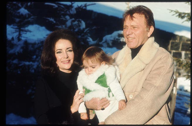 Elizabeth Taylor and Richard Burton hold their granddaughter Leyla in 1973 in Switzerland. The twice married pair jointly starred in films, as Who's Afraid of Virginia Woolf.