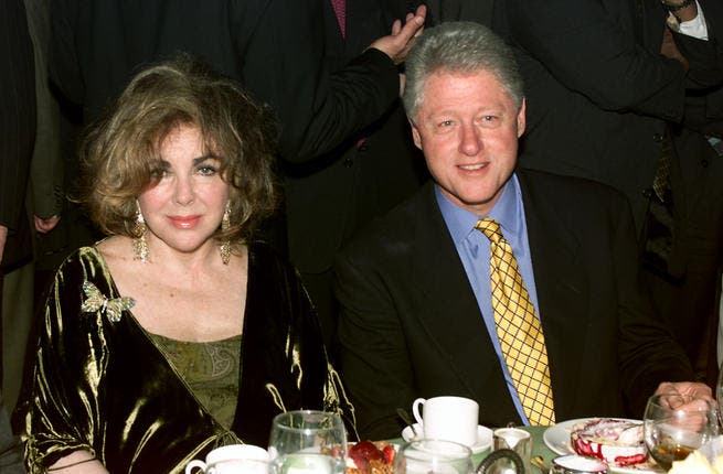 Dame Elizabeth Taylor and President Bill Clinton in 2001 at Beverly Hills. She was also close to other state leaders, such as Israeli Prime Minister Menachem Begin.
