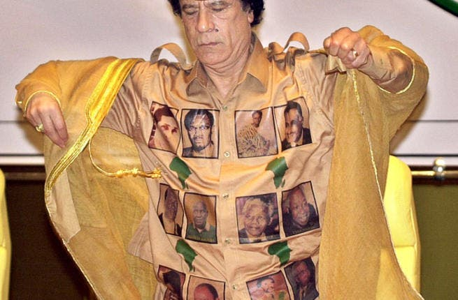 Proudly bearing his African 'kingdom's' heroes for all to get a closer look at. Leader of the African Union sports the ultimate Africa pride golden shirt marked in maps of the continent and faces of the Great Africans.