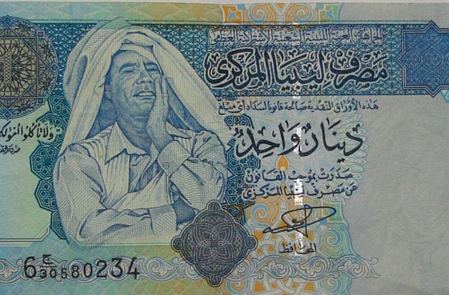 Proud enough to stamp his clownish image on his national exchange. The Qaddafi bill of choice!