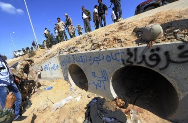 The last guards were male, with not a woman in sight: Found in a man-hole, Colonel Gaddafi and some of his remaining entourage were then subjected to man-handling by the enemy new regime National Council troops. No sign of the feisty  women who surrounded the failed leader in life, but not death.