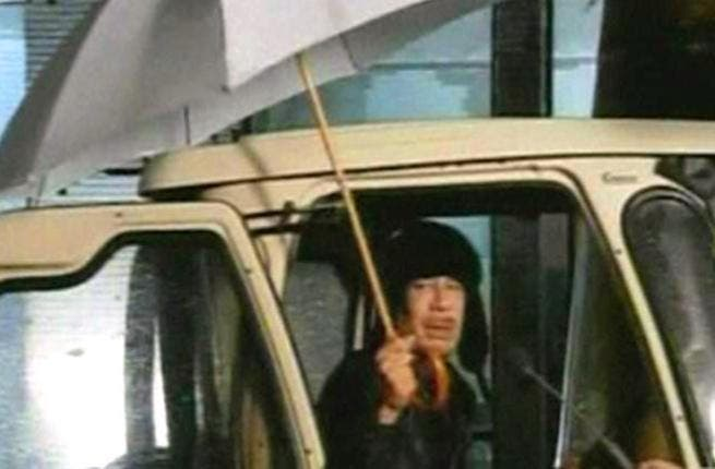 Libya's rainy day is Gaddafi's theatrical spotlight: Feb 22- Gaddafi makes first public appearance to disprove his fleeing- in a stilted surreal show : Bizarre starts to be the buzzword, together with the infamous umbrella pic.  He expresses  that, far from leaving Libya, he would