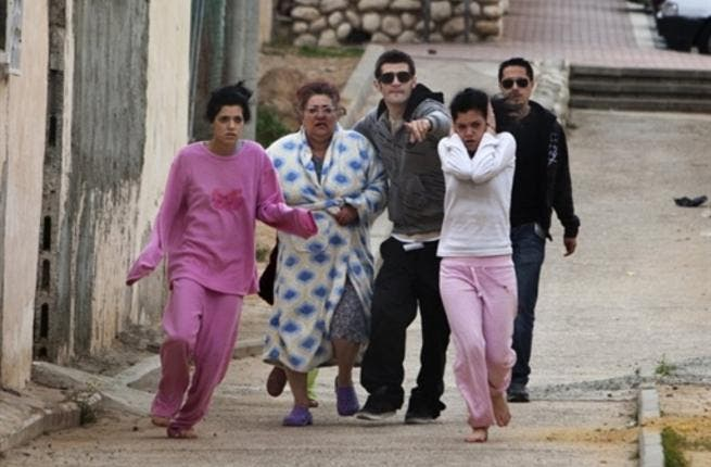 Israelis run to take cover in a shelter during a Palestinian rocket attack on the southern Israeli city of Beersheva, about 40 kilometres from the Gaza Strip as two Grad rockets fired by Gaza militants slammed into Beersheva.