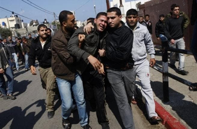 Palestinian mourners comfort each other during the funeral procession of Mohammed Atya Al-Harazine, a member of the Al-Quds Brigade, the armed wing of the Islamic Jihad, in Gaza.