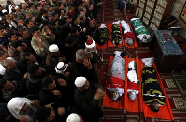 Palestinian mourners attend a funeral at a mosque in Gaza City. A day after eight Gazans were killed, among them two minors and four militants