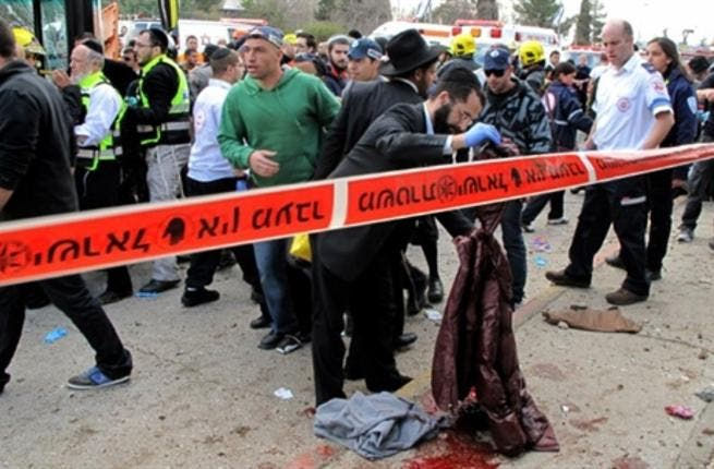 Israeli paramedics and emergency services rush to the scene of a massive bus explosion.