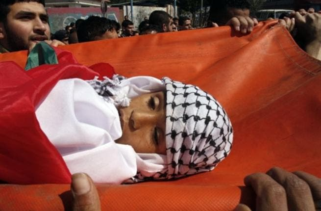 Palestinian mourners carry the body of 11-year-old Mohammed al-Helu during a funeral in Gaza City.
