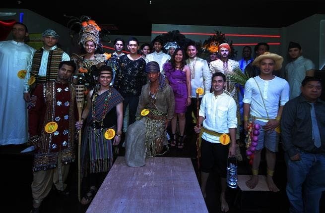Giving a worldly touch to the competition, the men donned their countries' traditional costume with some using the opportunity to flash a bit of flesh to the judges in their bid for victory!