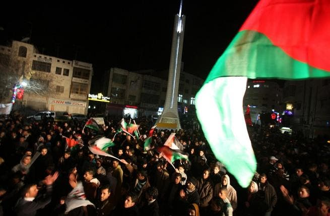 Palestinians injected a note of nationalism into their NY party as they huddled around the West Bank city of Ramallah waving flags to usher in 2013, their aspirational year of the new 'promised state', while flagging down 2012, the year of settlements, past.