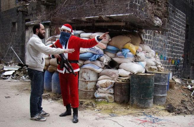 Syria's Santa was more likely to wield an AK-47 than a sack of gifts: The usual New Year cheers and revelry of Syria's ancient cities was replaced this year by staccato gunfire and the thud of shelling. In the capital, the few open bars and restaurants catered to those who could make it through the labyrinth of checkpoints and roadblocks.