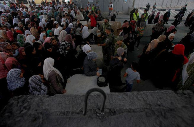 Steadfast at Qalandia - Palestinian women patiently line up at the Qalandia checkpoint in the hopes of crossing over for prayers at Al-Aqsa mosque. (AFP / Abbas Momani)