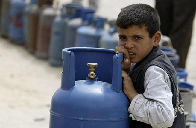 Rafah's bated breath at Ramadan- Gas supplies will suffer if the borders are kept closed. A Palestinian boy sits by a gas jar on the street as he awaits customers in Ramadan.