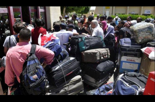 Enemy at the Gaza gates: Rafah - students in Egypt scramble to get back into Palestine before the borders close on them.