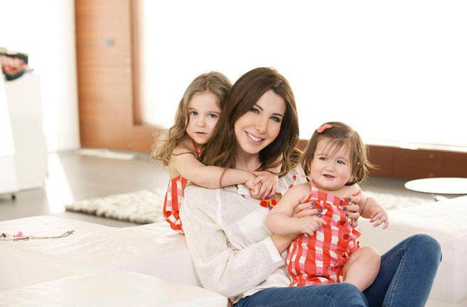 Fed up of their Mom always being the center of attention, Nancy Ajram's two young daughters have their sights set on the spotlight. Ella and Milla had all eyes on them when they starred in the video for their Mom's hit song, 'Ya Banat' (Oh Girls) last summer. Now they've tasted fame, the girls will be unstoppable in 2013.