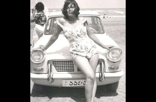 Tempting Tehran: This photo, from the 1960s, could be from any beach scene in the Western world, with a beautiful woman holding a seductive pose spread over a shiny sports car. Since the Iranian revolution in 1979, women, if at the beach at all, will be draped from head to toe in black and, at most fashionable, might brave the burkini.