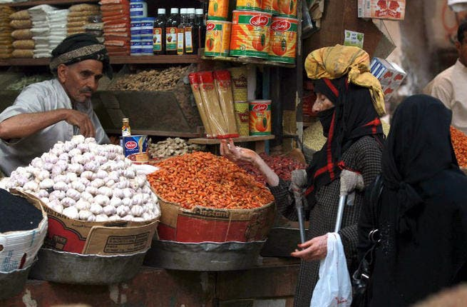 Food for thought for Yemen: A woman shops for food for Iftar at a local market in the Old City of Sanaa. July 4, 2013  (AFP PHOTO/ MOHAMMED HUWAIS)