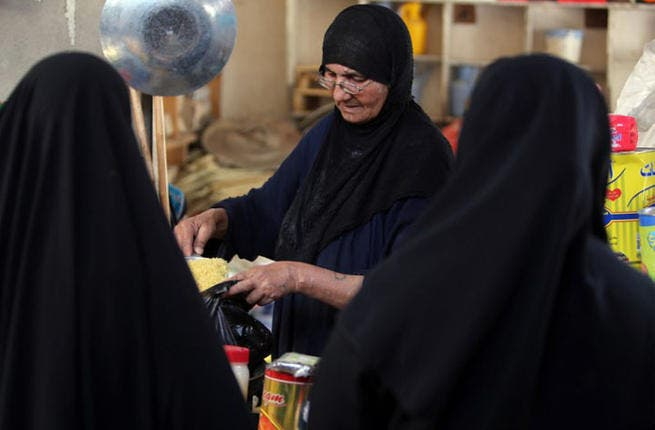 Stocking up for the hungry dusks: Iraqi women shop for food items in preparation for the Muslim fasting month of Ramadan at a market in Baghdad. July 9, 2013 (AFP PHOTO/AHMAD AL-RUBAYE)