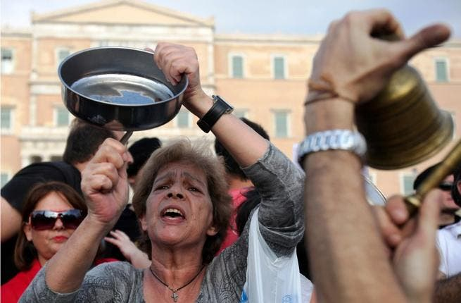 Mediterranean-blooded Spaniards enjoy a ruckus: In May, they clanked pots & pans to indicate growing hunger. The May 15 (15-M) Movement highlighted - boisterously - serious problems caused by financial crisis. By October, the capital's 'plaza' overflowed with people of the