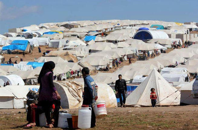 Syrians at a Turkish refugee camp (Getty)