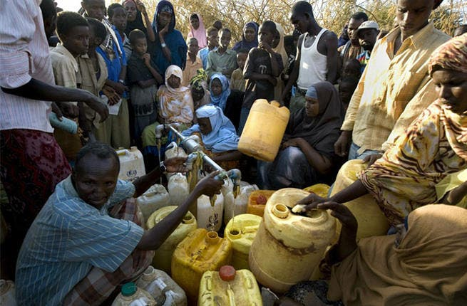Somali refugees wait for water, Dadaab, Kenya. The three camps at Dadaab, which were designed for 90,000 people, now have a population of about 250,000 Somali civilians (AFP)