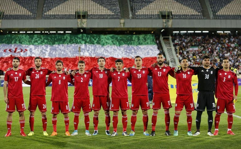 Iran's starting eleven line-up for their national anthem ahead of their international friendly match against Uzbekistan at Tehran's Azadi Stadium on May 19, 2018.