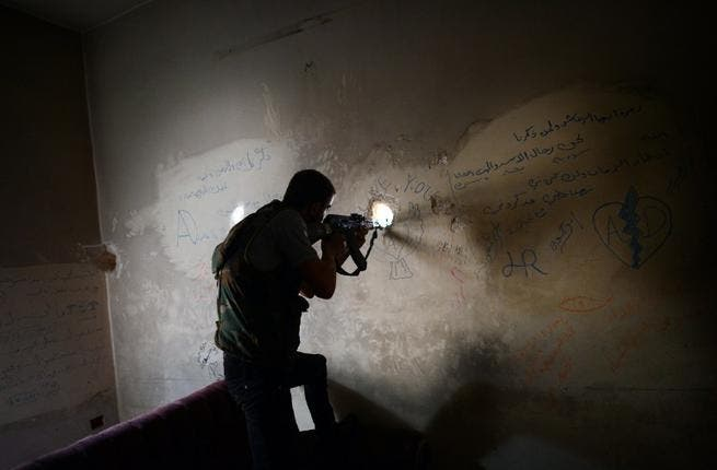 A Syrian rebel fires toward a government held area in Aleppo (AFP Photo/ Dimitar Dilkoff)