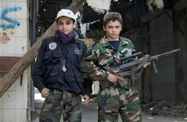 Free Syrian army's young fighters pose on April 2 (Guillaume Briquet/ AFP)
