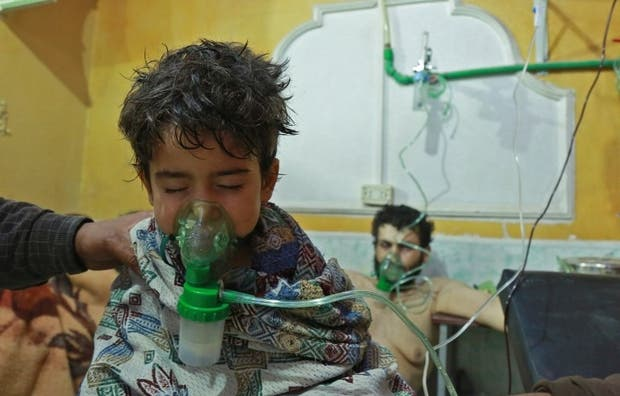 Syrians in a Eastern Ghouta hospital recover from a chemical attack (AFP/FILE)