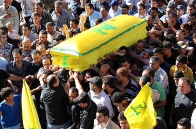 Hezbollah honors its dead fighter, killed in Syria in July, 2013 (Image Ali Dia / AFP)