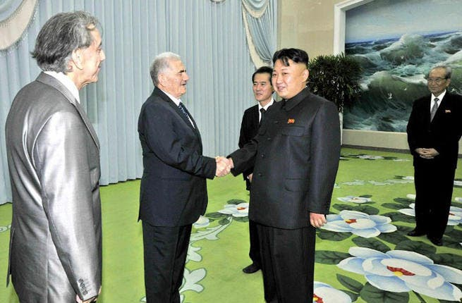 This picture, taken by North Korea's official Korean Central News Agency on July 24, 2013 shows North Korean leader Kim Jong-Un shaking hands with Abdullah al-Ahmar, deputy general secretary of the Syria's Baath Arab Socialist Party in Pyongyang.