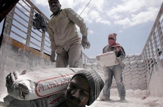 Syrian workers eyed with suspicion as Jordanian government looks to legitimize workers. [Haytham al-Moussawi]
