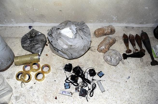SYRIA, JOBAR : A handout picture released by the Syrian Arab News Agency (SANA) on August 24, 2013 shows bags of what the Syrian government claims to be materials used to make chemical weapons discovered in Jobar on the outskirts of the capital Damascus. AFP PHOTO / HO / SANA