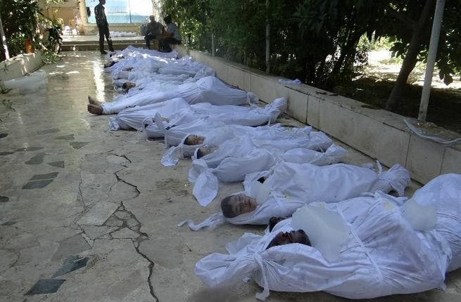 A handout image released by the Syrian opposition's Shaam News Network shows bodies of children wrapped in shrouds as Syrian rebels claim they were killed in a toxic gas attack by pro-government forces in eastern Ghouta, on the outskirts of Damascus on August 21, 2013. AFP PHOTO / HO / SHAAM NEWS NETWORK