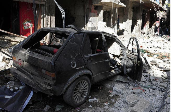 A car bomb has killed at least twenty people in Rankus, a town 30 kilometers north of Damascus. The attack is the latest in a series of deadly bombings in Syria. (Image credit: AFP)