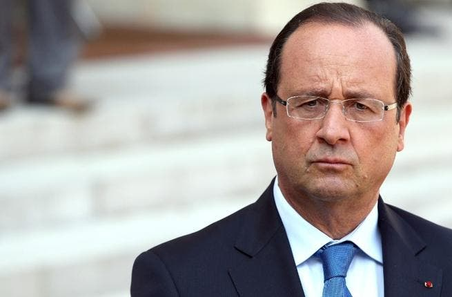 FRANCE, Paris : France's President Francois Hollande speaks during a press conference after a meeting with the President of the National Coalition for Syrian Revolutionary and Opposition Forces (SNC) at the Elysee presidential palace on August 29, 2013 in Paris. AFP PHOTO / KENZO TRIBOUILLARD