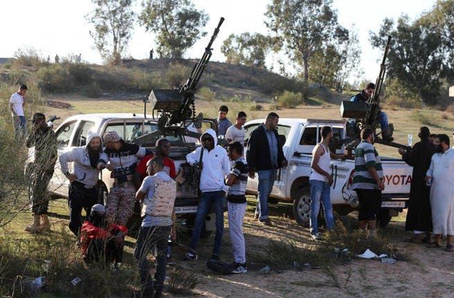 Members of the Tripoli Rebels Brigade militia patrol a main road in Tajura, 15 kms from the capital Tripoli. (Image credit: AFP)