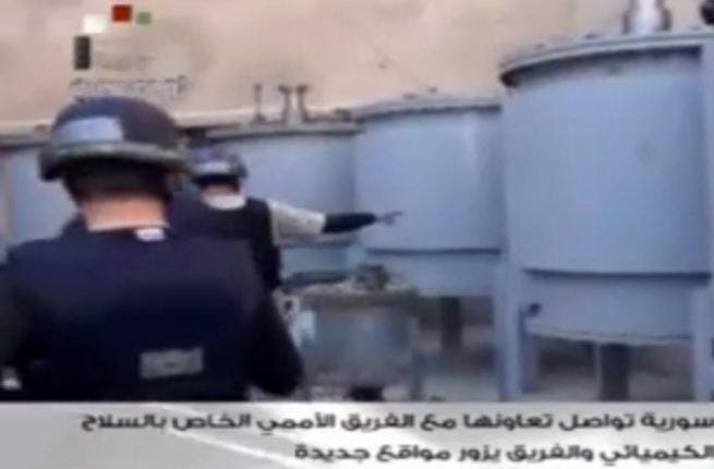 An image grab taken from Syrian television on October 19, 2013 shows inspectors from the Organization for the Prohibition of Chemical Weapons (OPCW) at work at an undisclosed location. (Image credit: AFP)