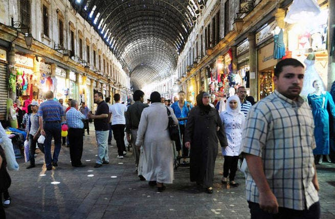 Syrians shop in the covered market in centreal Damascus on July 9, 2013 as they prepare for the Muslim holy fasting month of Ramadan.( AFP PHOTO / STR)
