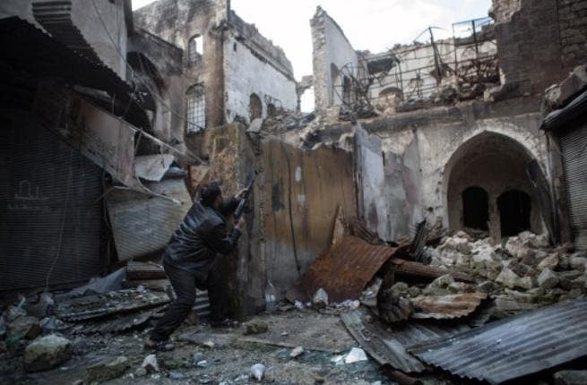A Syrian rebel takes aim amid destruction (AFP)